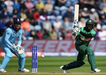 CARDIFF, WALES - JUNE 08: Shakib Al Hasan of Bangladesh plays a shot as Jonny Bairstow of England looks on during the Group Stage match of the ICC Cricket World Cup 2019 between England and Bangladesh at Cardiff Wales Stadium on June 08, 2019 in Cardiff, Wales. (Photo by Harry Trump/Getty Images)